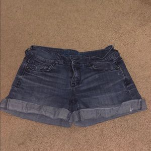 Lightly distressed cuffed jean shorts